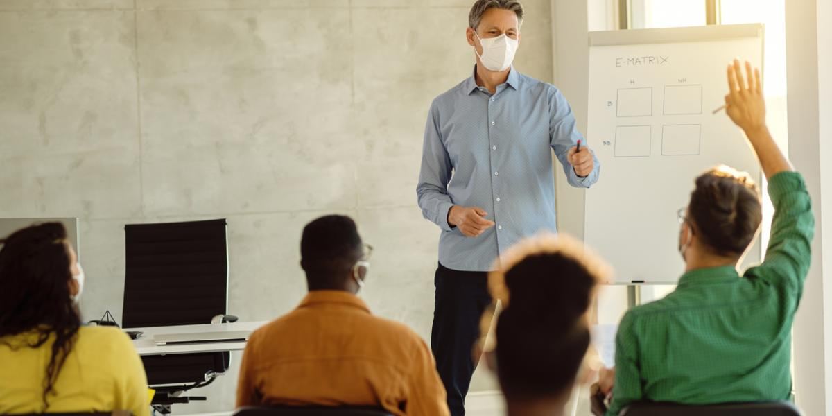 University male teacher with mask in class